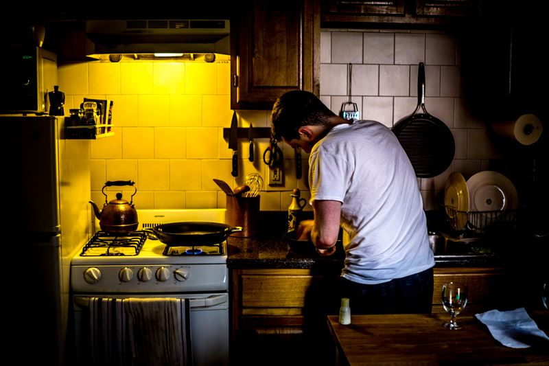 Man standing in the kitchen cooking
