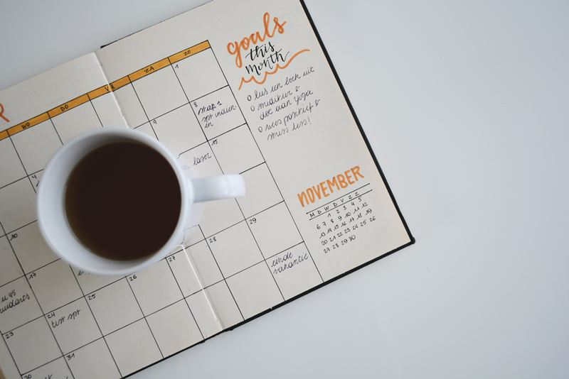 coffee cup on a goal planner.